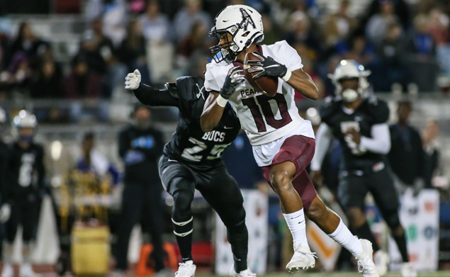 GREAT CATCH - Pearland junior wide receiver Cedric Mitchell (10) hauls in a pass against Brazoswood. The Oilers beat the Bucs 45-0 to secure their place in the playoffs. Pearland is now 7-2 overall and 4-2 in district. Pearland will hose George Ranch on Friday, November 8 at The Rig at 7:00 p.m. (Photo by Lloyd Hendricks)