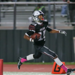 PEARLAND TOUCHDOWN - Pearland wide receiver William Foster scores on a 46-yard pass from QB Jake Sock to give the Oilers a 6-3 lead over Dawson with 3:40 left in the first half. The PAT was blocked leaving the score at 6-3. The Eagles rallied in the second half to win the annual Bayway Chevrolet PearBowl 17-6 for the second consecutive year. Dawson has a 4-3 edge in the series. (Photo by Lloyd Hendricks)