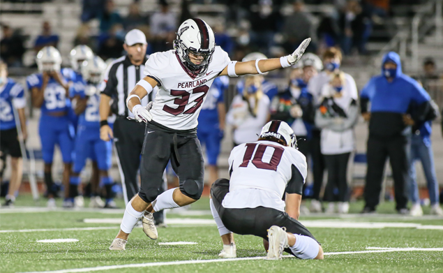RIGHT ON TARGET - Pearland senior placekicker Caleb Mendez (33) booted field goals of 35, 40, and 37-yards plus 5-for-5 PATs in sparking the Oilers over Clear Springs 44-37 in the Class 6A Region III Div. I bi-district round of the playoffs. Issac Sanchez (10) is the holder. Pearland will face Atascocita on Friday, December 18 at 7:00 p.m. at Sheldon ISD Panther Stadium. The Eagles are 6-2 overall and defeated Pasadena Dobie 54-14 to advance to face the Oilers. (Photo by Lloyd Hendricks)