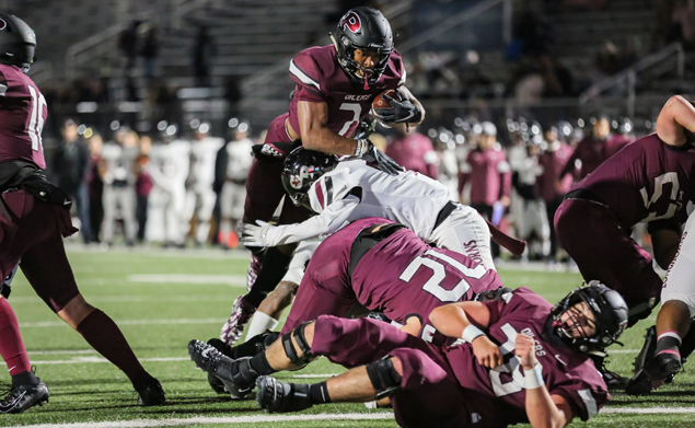 UP AND OVER - Pearland junior running back Brandon Campbell (7) leaps over the offensive line to score on a 1-yard touchdown. Campbell rushed for 80-yards on 13 carries and scored four TDs on runs of 1, 32 1, and 37-yards to lead the Oilers to a 49-7 pounding of George Ranch. Pearland will face Dickinson in the Class 6A Region III Div. I bi-district playoffs on Friday, November 15 at 7:00 p.m. at Sam Vitanza Stadium in Dickinson. (Photo by Lloyd Hendricks)