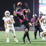 SCORING GRAB - Pearland QB Jake Sock tossed a 20-yard touchdown pass to Dylan Dixson for a 21-0 lead in the first quarter against the Alvin Yellowjackets.. The Oilers went on to a 48-9 district win to close out the regular season at 7-2. The Oilers punched their ticket to the Class 6A Region III Div. I playoffs for the 21st straight season. (Photo by Lloyd Hendricks)