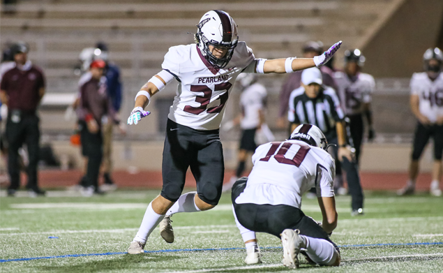 RIGHT ON TARGET -- Pearland senior placekicker Caleb Mendez (33) hits a 32-yard field goal against Alief Elsik as the Oilers beat the Rams 43-13 to improve to 4-1 on the season. The talented kicker also booted four PAT's to score seven of his team's 43 points. The hard-working Mendez is one of the more talented kickers in the Houston area. Isaac Sanchez (10) is the holder for Mendez. (Photo by Lloyd Hendricks)