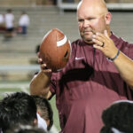 100th WIN - Pearland head football coach Ricky Tullos was presented the game ball following the Oilers' 49-23 victory over the Spring Branch Memorial Mustangs. Pearland principal John Palombo presented the ball to Tullos to celebrate his 100th career win as a head football coach. He has a career mark of 100-28 and counting. (Photo by Lloyd Hendricks)