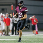 Pearland wide receiver Clayton Broeder (21) grabs a pass from QB J.D. Head and turns it into a 56-yard scoring pass to cut the Memorial lead to 17-14 with 10:05 left in the final quarter. The No. 9 area-ranked Oilers would score the winning TD on a 3-yard run by Austin Landry to pull out a 21-17 non-district win to improve to 2-0 on the season. (Photo by Lloyd Hendricks)