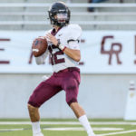 RECORD SETTER - Pearland quarterback J.D. Head (12), who moved to Pearland from Oklahoma back in the summer, has already made his presence known, as the junior field-general broke two passing records for the Oilers in a 56-28 win over Cinco Ranch. Head threw for 357 yards and six touchdowns which broke former All-State quarterback Trey Anderson's single-game record of 314 yards that he set when the Oilers beat Katy 38-35 in the 2010 Class 5A Region III Div. I finals. Pearland ended up winning the 5A Div. I state title that season. The six touchdown passes by Head also set a new standard beating the previous mark of four touchdown passes in a single-game by a couple of former Pearland quarterbacks. (Photo by Lloyd Hendricks)