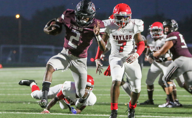 TRIFECTA - Pearland running back Jaelin Benefield (2) scored three touchdowns and each one was 2-yard runs. The speedster had 24 carries for 148 yards in leading the Oilers to a 28-0 win over Alief Taylor in the District 23-6A opener for both teams. (Photo by Lloyd Hendricks)