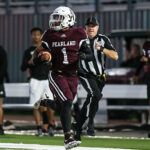 RECORD-SETTING RECEIVER - Pearland wide receiver Izeal Jones (1) catches a touchdown pass covering 83-yards on the opening possession for the Oilers against Strake Jesuit. Jones set a new PHS single-game mark for receiving yards of 212 yards on four catches and a pair of TDs. Jones caught another touchdown pass covering 55-yards from QB Jake Sock. The Oilers beat the Crusaders 41-20 in the district opener for both teams. (Photo by Lloyd Hendricks)