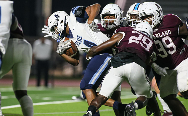 PEARLAND DEFENSE - Pearland limited Alief Elsik to only six points in the Oilers' 42-6 homecoming win. Ian Ejedepang-Koge (29) and Elijah Cavitt-Holbert (99) and others stopped wide receiver Adryan Brown (4) on this play. (Photo by Lloyd Hendricks)